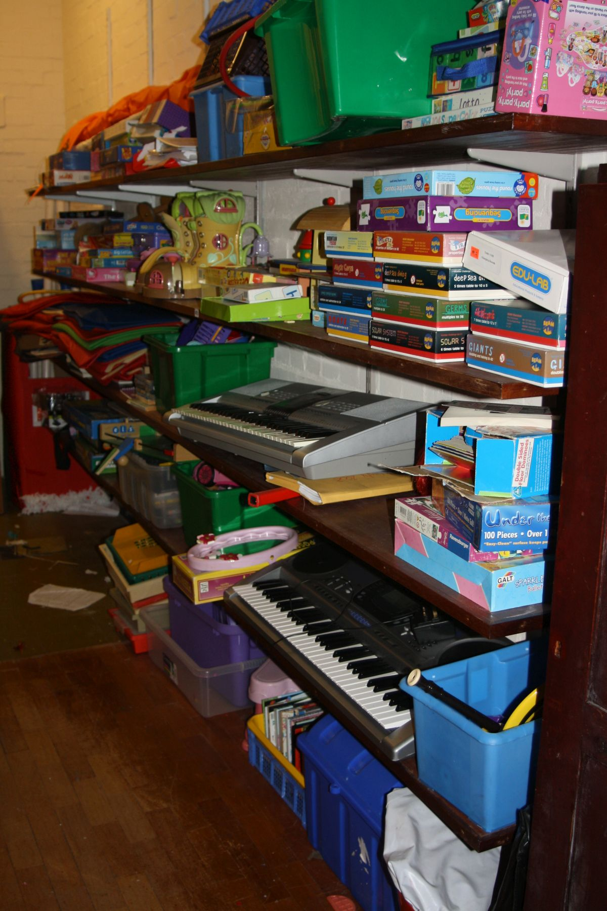 Lot 873 - THE CONTENTS OF FIVE SHELVES, including electronic keyboards, toys, games, etc