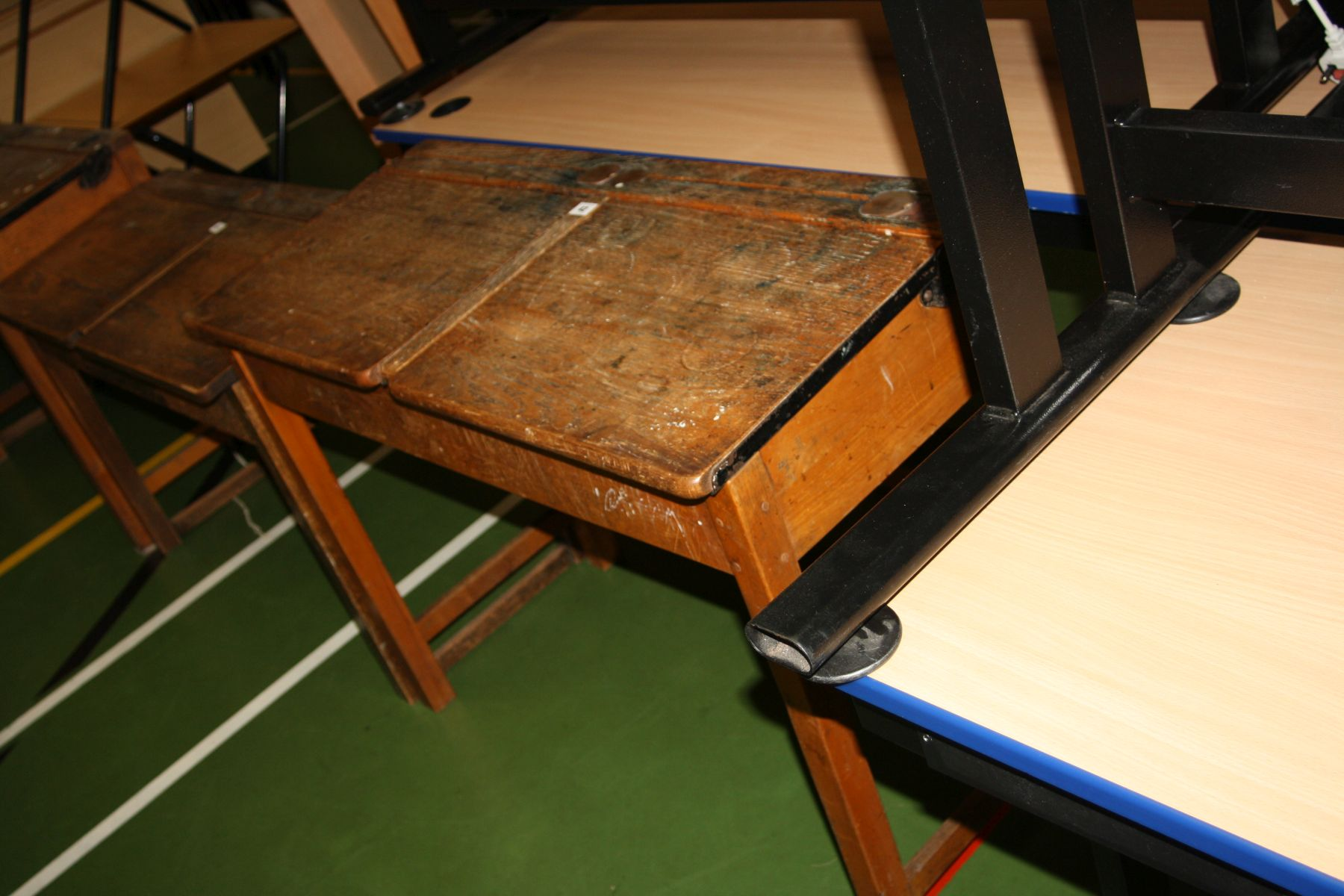 Lot 42 - A VINTAGE DOUBLE SCHOOL DESK, with oak top, two lift up lids, two copper sliding ink well cover