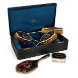 A cased silver and silver inlaid tortoiseshell dressing table set, London c.1911/1914, William