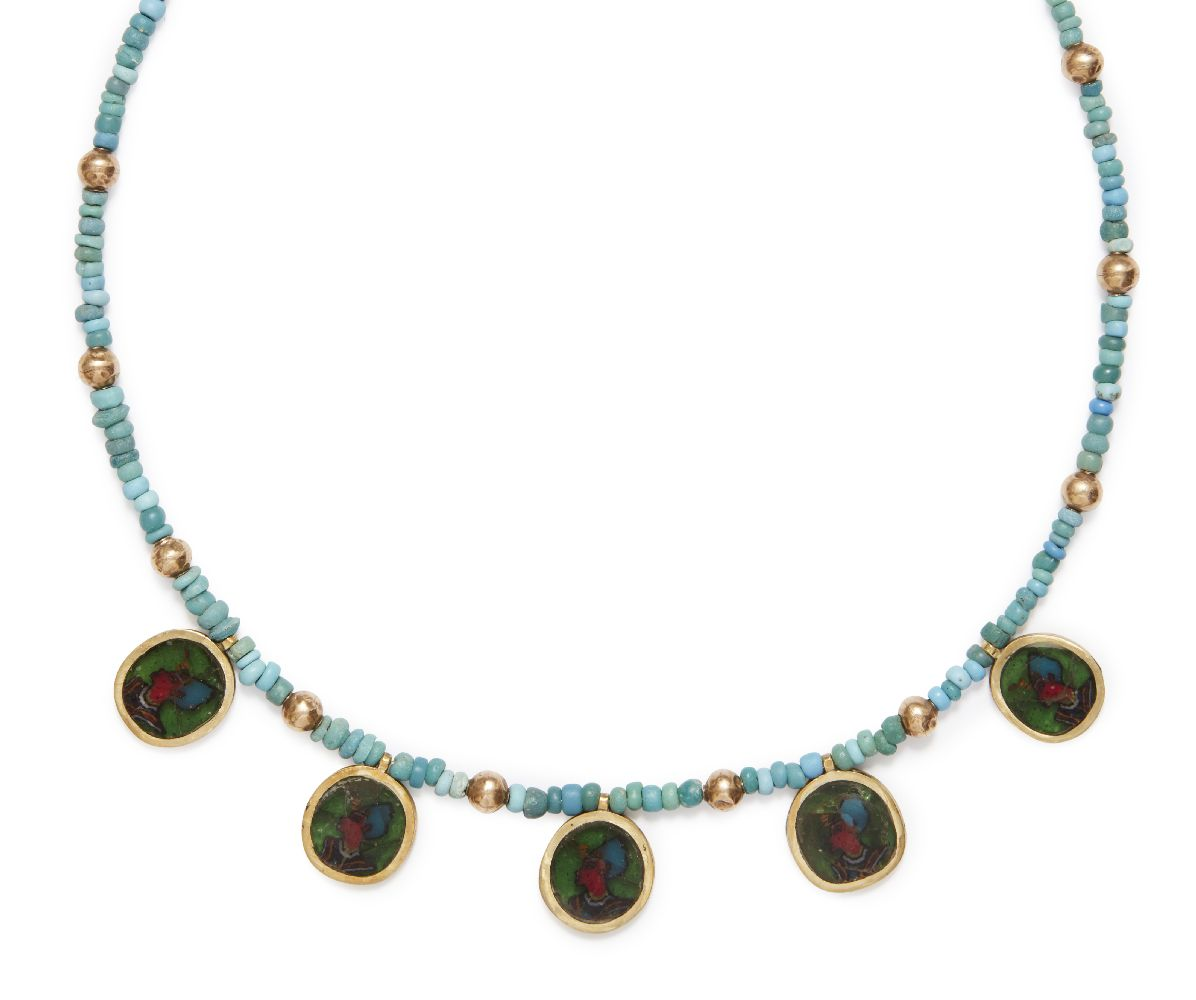 Lot 57 - An ancient coloured glass necklace with Egyptians heads in modern gold pendant mounts, 1st-2nd