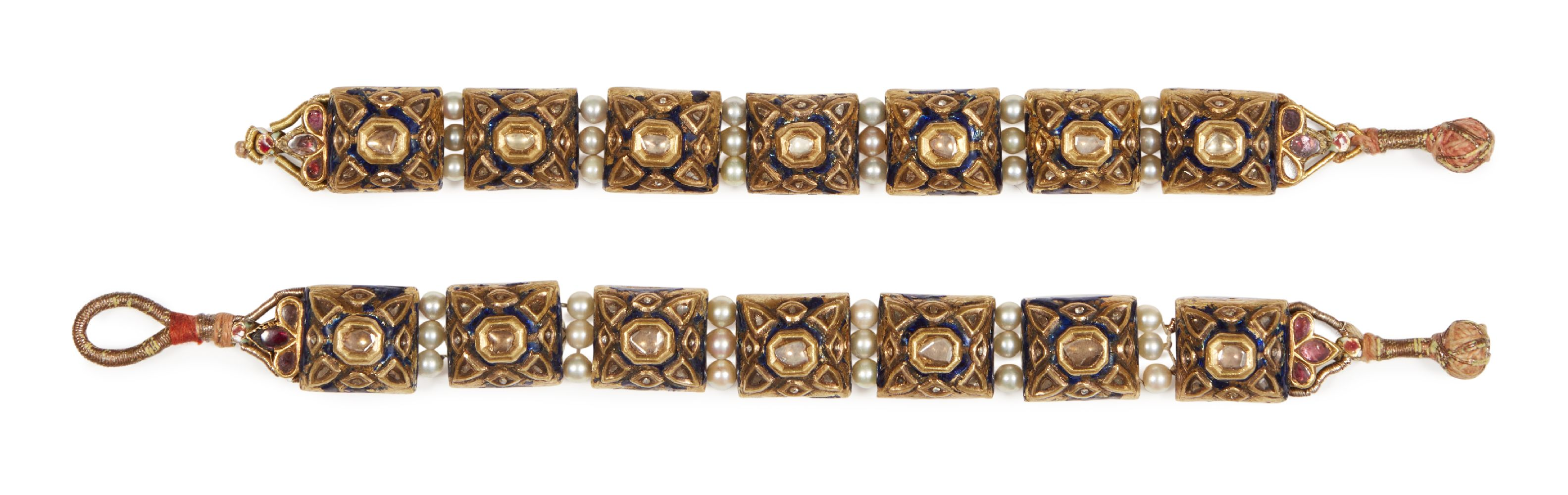 Lot 448 - A pair of gold pearl and gem-set enamelled bracelets, India, late 19th-early 20th century, each