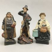 Three 19th century German painted terracotta figures
