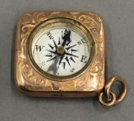 A 9 ct gold novelty compass charm (4 grammes total weight)