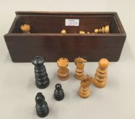 A 19th century turned wood chess set,