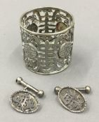 A pair of Chinese silver cufflinks together with a Chinese white metal napkin ring (22.