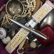 A quantity of miscellaneous items, including watches, pens, etc.