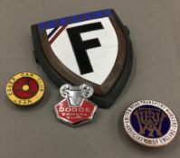 A quantity of enamel transport related badges