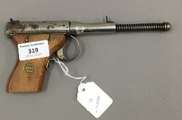 An early 20th century Dolla Mark II 'Gat Type' .177 air pistol by J. G.