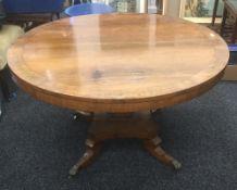 A Regency brass inlaid rosewood breakfast table