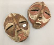 Two painted African tribal type wooden masks