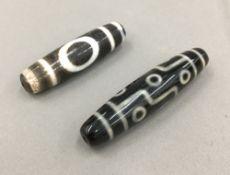 Two agate Tibetan beads