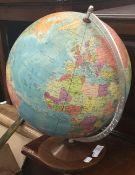 A vintage desk top globe on stand
