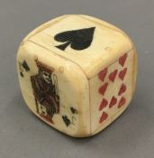 A bone box formed as a dice containing small dice