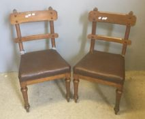 A pair of Victorian oak framed Gothic side chairs