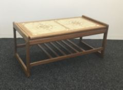 A tile top coffee table