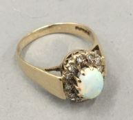 A 9 ct gold opal and diamond ring