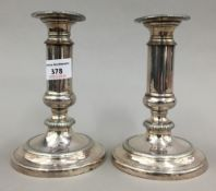 A pair of Sheffield plate telescopic candlesticks