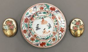A finely painted Japanese Satsuma pottery belt buckle with signed silver mounts circa 1900 and a