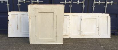 A Victorian white painted pine cupboard and a large Victorian white painted pine cupboard front