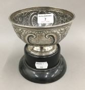 A small silver bowl on stand