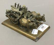 An Indian brass model of oxen pulling a cart