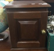 A mahogany table cabinet fitted with two drawers