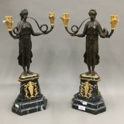 A pair of bronze Empire style candelabra