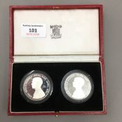 A pair of silver proof coins,