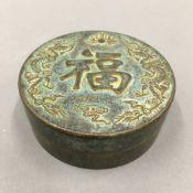A Chinese bronze round box