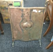 An early 20th century copper fire guard