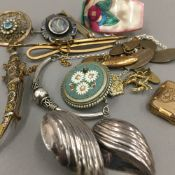 A collection of various brooches, etc.