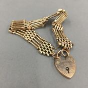 A 9 ct gold bracelet with a 9 ct gold padlock (18 grammes total weight)