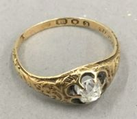 An 18 ct gold diamond ring (spreads to 0.