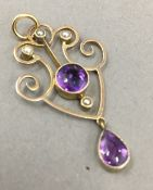 An Edwardian 9 ct rose gold amethyst and seed pearl La Vella drop pendant