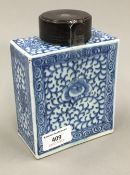 A 19th century Chinese porcelain rectangular tea caddy painted with swirling design,