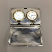 A silver cased travelling clock and barometer