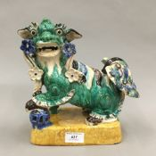A Chinese glazed earthenware dog-of-fo