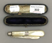 A cased mother-of-pearl handled silver fruit knife