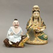 A 19th century Continental porcelain figural scent bottle and a Satsuma Guanyin