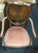 An Edwardian inlaid mahogany open armchair