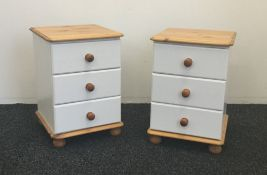 A pair of modern white painted bedside drawers and a modern white painted standing bookcase
