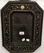 A 19th century Continental ebony and bone inlaid wall mirror.
