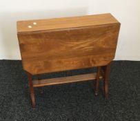 A Victorian walnut Sutherland table