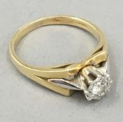 An 18 ct gold diamond solitaire ring (4 grammes total weight)
