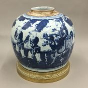 A 19th century Chinese blue and white ginger jar on a gilt bronze stand