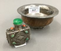 A 19th century Tibetan silver and wood temple bowl and a 19th century Chinese square section silver