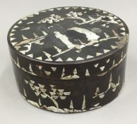 A Chinese mother-of-pearl inlaid lacquered box