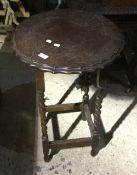 An early 20th century oak barley twist side table