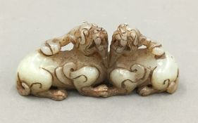 A jade carving formed as two dogs-of-fo