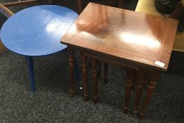 A nest of three table and a blue painted coffee table
